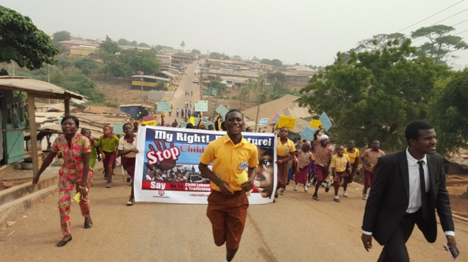Children Float and parade through streets advocating against child trafficking